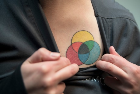 Jess S. hides her tattoos while working for the hospital UPMC. as an ophthalmic photographer.